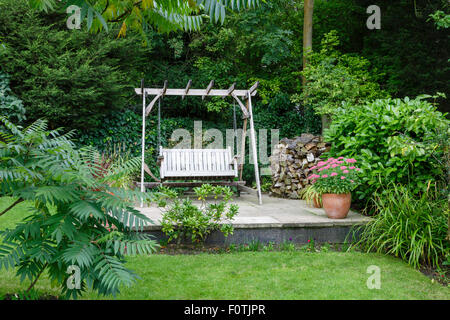 Back garden and patio with furniture in a British home - Stock Photo