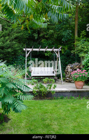 Patio furniture on a terrace in a British garden - Stock Photo