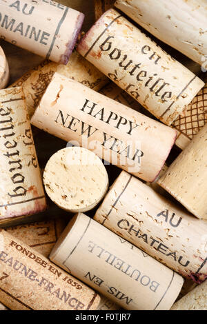 Happy New Year template with vintage wine corks - Stock Photo