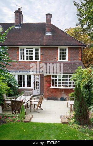 Back of a traditional 1930's English house and garden - Stock Photo