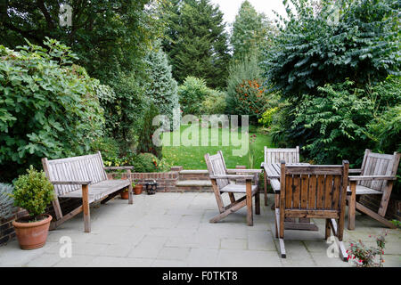 Backyard, patio and garden furniture in an English home - Stock Photo