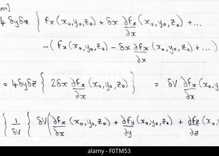 Hand written study notes for math with equations for divergence of vector fields - Stock Photo