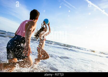 Young couple fooling around in sea - Stock Photo