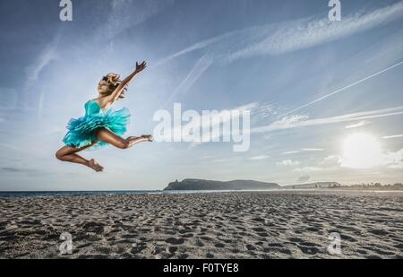 Young female dancer leaping, in mid air, Cagliari, Sardinia, Italy - Stock Photo