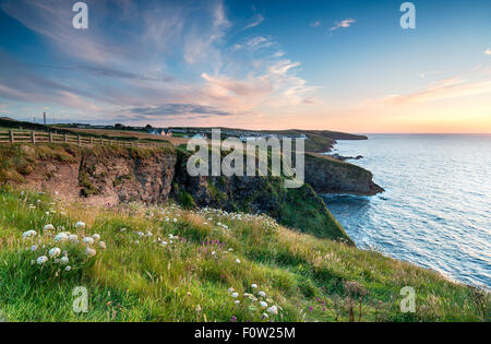 Sunset from cliffs above Port Gaverne and looking out to Port Isaac - Stock Photo