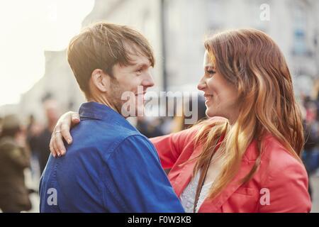 Romantic couple face to face on street, London, UK - Stock Photo