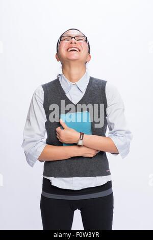 Businesswoman hugging digital tablet, laughing - Stock Photo