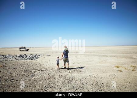 Father and sons enjoying view, Kubu Island, Makgadikgadi Pan, Botswana, Africa - Stock Photo
