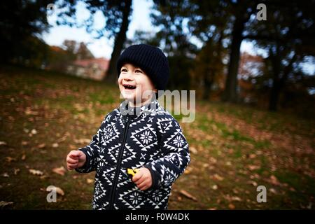 Boy playing in park - Stock Photo