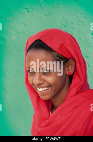 Portrait of Amhara woman wearing red headscarf, Ethiopia, Africa - Stock Photo
