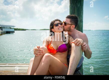 Young couple on sea pier, Islamorada, Florida, USA - Stock Photo