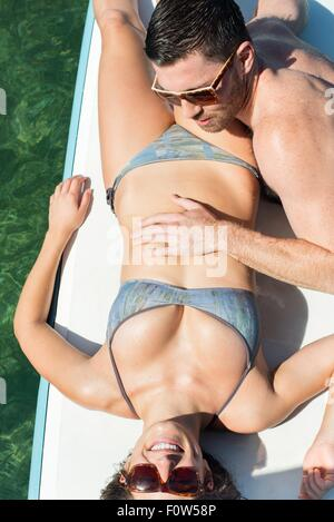Overhead view of romantic young couple on paddleboards - Stock Photo