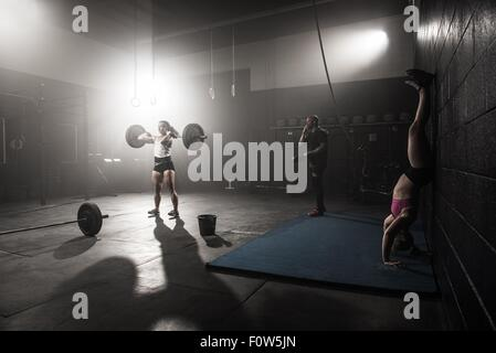 Group of people working out in gym - Stock Photo