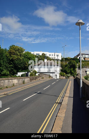 Shaldon bridge, over the river Teign, looking towards the old toll house. - Stock Photo