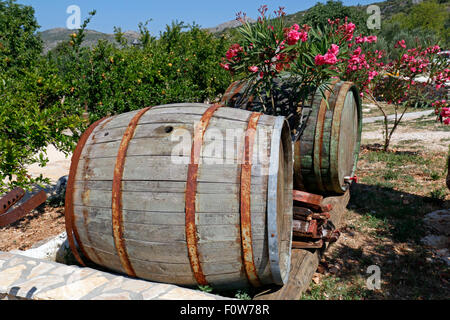 Old wooden barrels with rusty hoops - Stock Photo