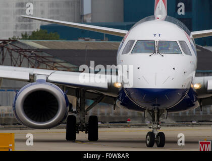 A British Airways BA CityFlyer Embraer ERJ-190 registration G-LCYT taxis for take off from London City Airport LCY - Stock Photo