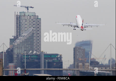 A British Airways BA CityFlyer Embraer ERJ-170 registration G-LCYF takes off at London City Airport LCY - Stock Photo