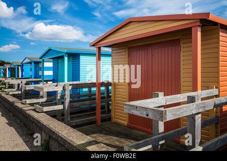 Colourful beach huts in the Kentish coastal resort of Whitstable. - Stock Photo