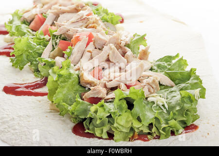 Traditional unfolded shawarma with chicken and vegetables just before wrapping - Stock Photo