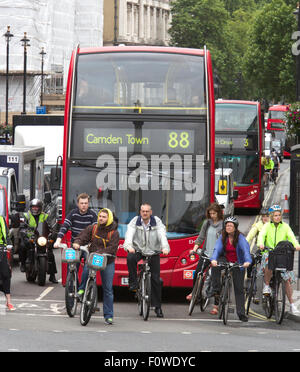 Cyclists crowd a junction near Trafalgar Square, London, Britain. - Stock Photo