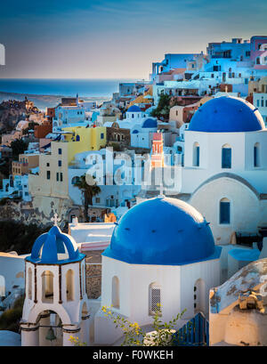 Iconic blue domed chapels in the town of Oia on the greek island Santorini (Thera) - Stock Photo