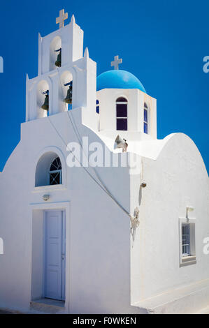 Iconic blue domed chapel in the town of Thira on the greek island Santorini (Thera) - Stock Photo