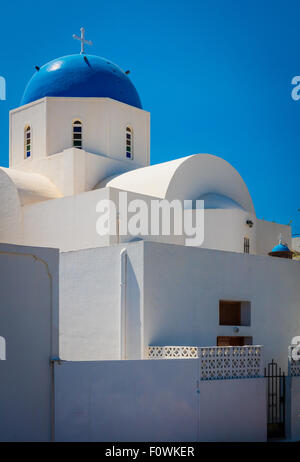 Iconic blue domed church in the town of Thira on the greek island Santorini (Thera) - Stock Photo