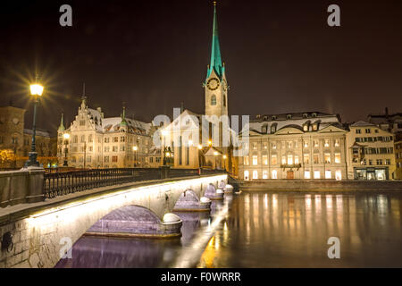 Nightscene at the banks of river Limmat in Zurich - Stock Photo