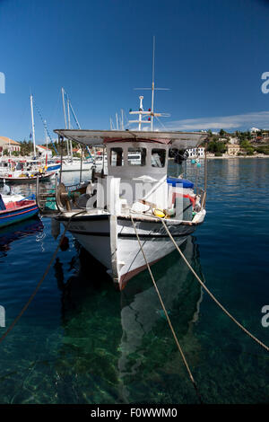 A small local fishing boat, Fiscardo  harbour on the Greek Island of Kefalonia, home to the film 'Captain Corelli's - Stock Photo