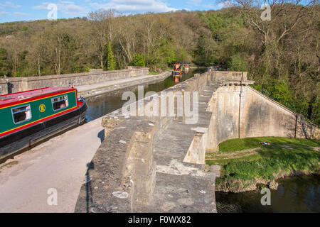 Narrow boat barge on Dundas Aqueduct carrying Kennet and Avon Canal over the river Avon near Limpley Stoke Wiltshire - Stock Photo