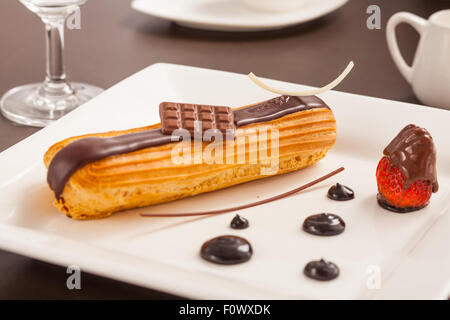 Éclair on a plate - Stock Photo