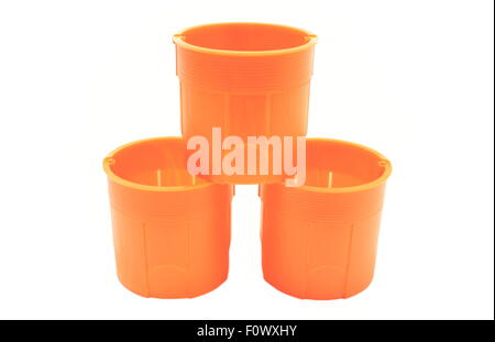 Stack of orange plastic electrical boxes on white background Stock ...