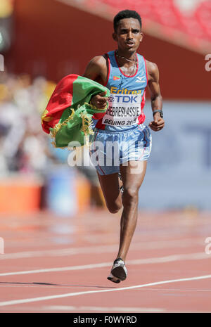 Beijing, China. 22nd Aug, 2015. Eritrea's Ghirmay Ghebreslassie finishes the Men's Marathon competition during the - Stock Photo
