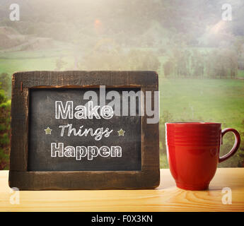 Make Things happen inscribed on blackboard rustic style - Stock Photo