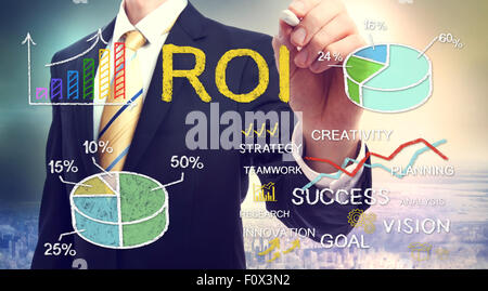 Businessman drawing ROI (return on investment) with graphs - Stock Photo