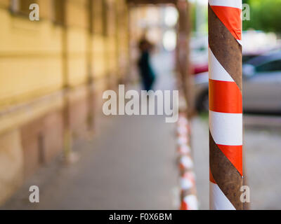 Blured backgroud with hazard tape, red white tape - Stock Photo