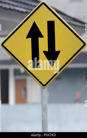 road sign Two way traffic ahead, watch for oncoming traffic ahead - Stock Photo