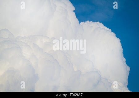 cumulonimbus clouds against a beautiful blue sky - Stock Photo