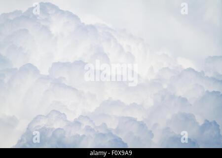Cumulonimbus clouds brewing a thunderstorm - Stock Photo