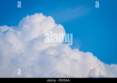 cumulonimbus clouds against a beautiful blue sky - Stock Photo