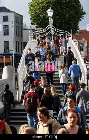 Ha Penny bridge and people. Dublin. Ireland. Europe - Stock Photo