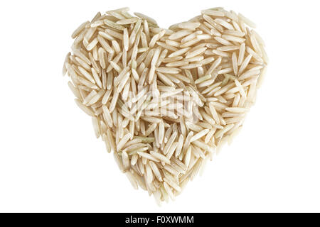 Heart shape made of wholegrain basmati rice viewed from above, isolated on white background. - Stock Photo