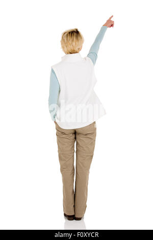 rear view of middle aged woman pointing at empty copy space - Stock Photo