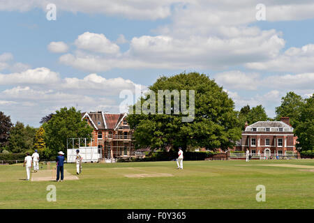 A cricket match in progress at the famous Vine cricket ground in Sevenoaks, Kent, UK - Stock Photo
