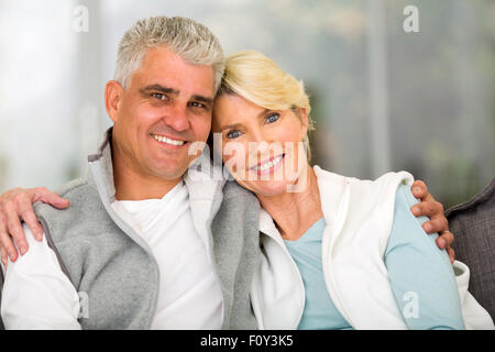 portrait of happy mature couple relaxing at home - Stock Photo