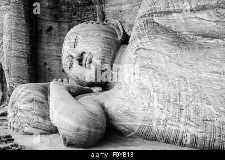 The Reclining Buddha at Gal Vihara, Polonnaruwa, Sri Lanka - Stock Photo