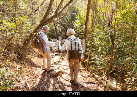 senior couple on a hiking trip in the mountain - Stock Photo