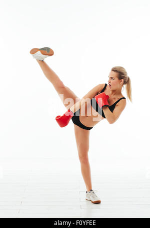 Fitness healthy women boxing in studio isolated - Stock Photo