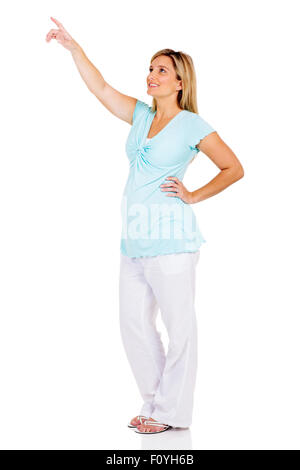 happy pregnant woman pointing at empty copy space - Stock Photo