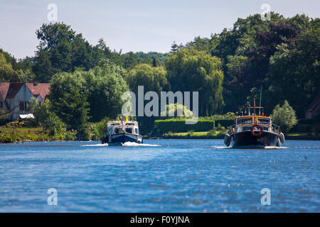 Boats on the river Scheldt near Ghent, Belgium - Stock Photo